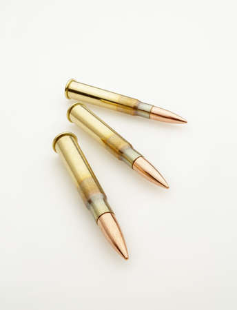 Large Caliber Bullets Catridges Isolated on White Wide Angle Stock Photo