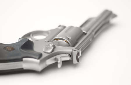 concealed: Stainless 357 Magnum Revolver on White Shallow Focus