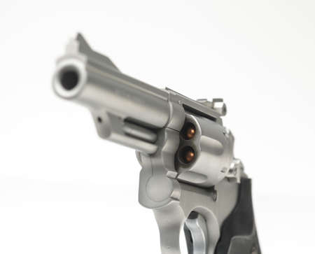 constitutional law: Stainless 357 Magnum Revolver on White Shallow Focus