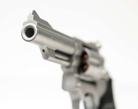 hand gun: Stainless 357 Magnum Revolver isolated on White Shallow Focus
