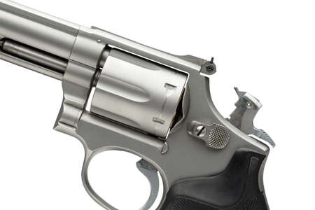 cocked: Stainless 357 Magnum Revolver Cocked on White Stock Photo
