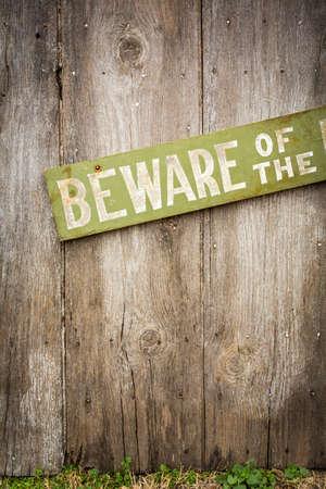 burglar protection: Beware Of Dog Sign on Old Worn Wood Fence