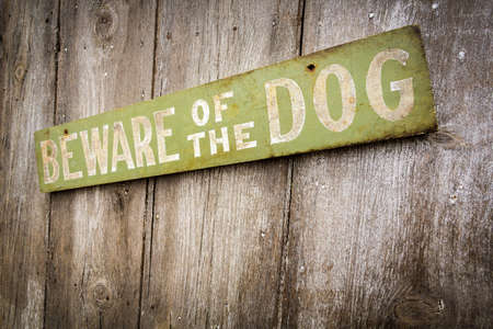 Beware Of Dog Sign on Old Worn Wood Fence