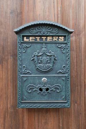 metal post: Mailbox on the door