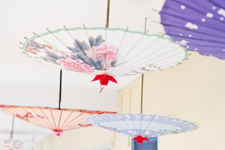 Oil-paper umbrella is a kind of paper umbrella originated in China Stock Photo - 9365294
