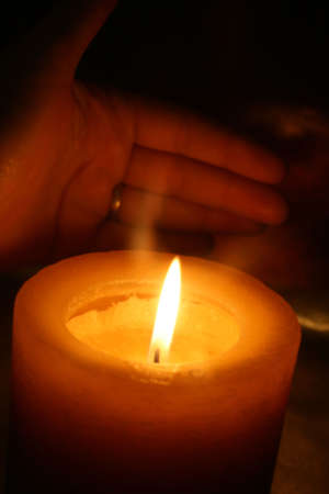 Candle and Hand photo