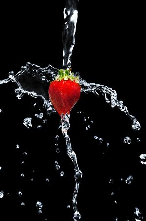 Strawberry in water on a black background photo