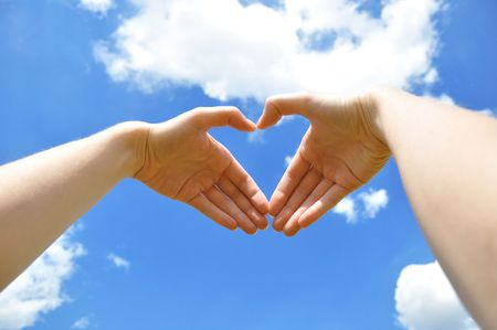 loveliness: Hands representing heart against the sky