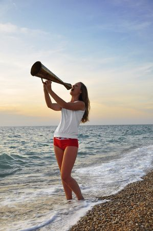 pronounce: girl shouting into a megaphone at sea