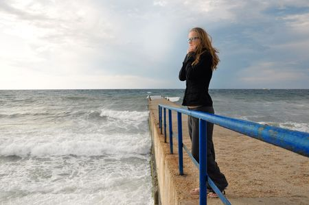 lonely person: Lonely girl by the sea