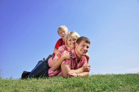 Young Family Lying on the Grass in Park Stock Photo - 5529086