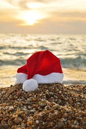 Santa Claus hat on the beach photo