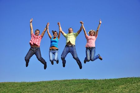Big group of young jumping people with hands up photo