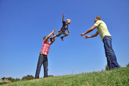 A father throwing his son in the air and catching him
