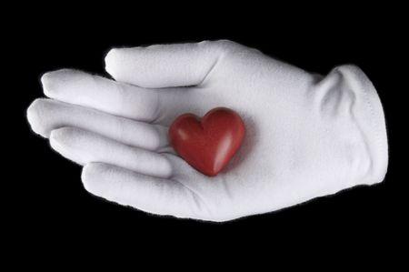 gant blanc: c?ur rouge dans sa main dans un gant blanc