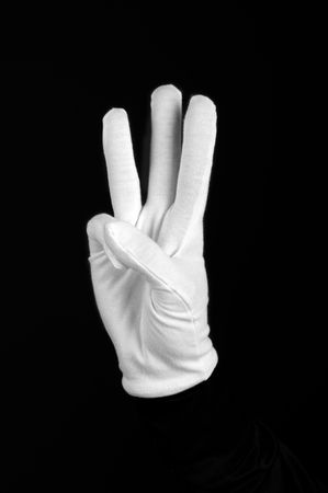 white-gloved hand on a black background photo