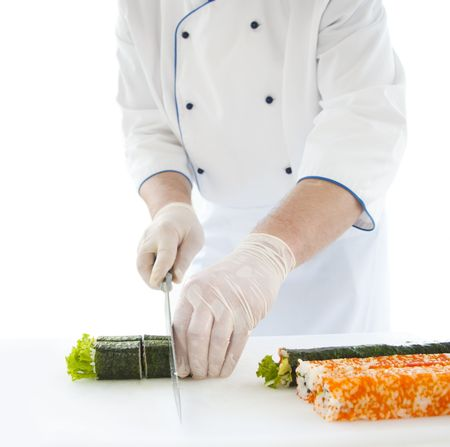chef prepares Japanese food - sushi. On the table, the ingredients for sushi 免版税图像