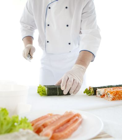 chef prepares Japanese food - sushi. On the table, the ingredients for sushi Stock Photo
