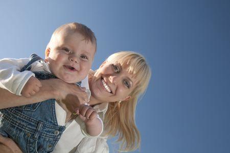vaderlijk: little boy at the hands of his mother, paternal care