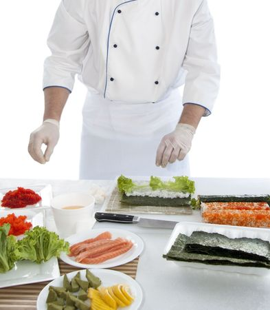 chef prepares Japanese food - sushi. On the table, the ingredients for sushi Stock fotó