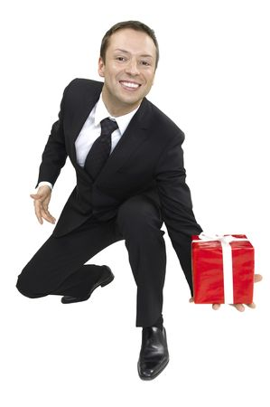 young business man handed a box with a gift in hand photo