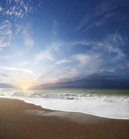 Gorgeous Beach in Summertime, Storm clouds with sun over sea Stock Photo