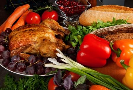 Roasted holiday turkey garnished with sourdough stuffing and fruit photo