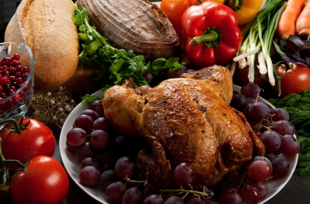 feasts: Roasted holiday turkey garnished with sourdough stuffing and fruit