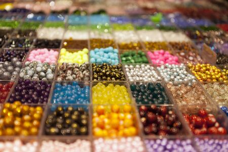 multi-colored beads in a box on a shelf in the market Stock Photo - 12932434