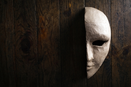 half of the paper masks on a wooden background