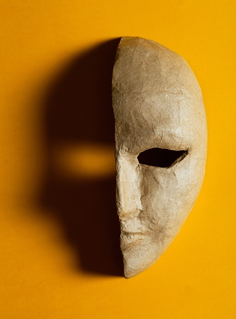 half of the paper masks on a yellow background photo