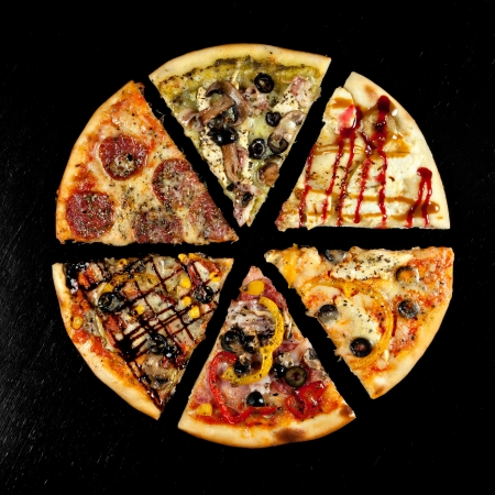 six slices of pizza with different toppings on a black background