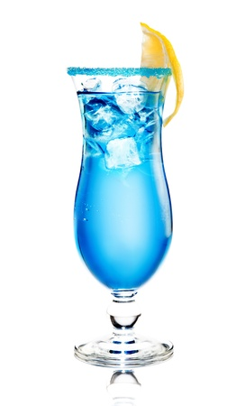 alcoholic cocktail  Blue Lagoon  with ice on a white background  The edge of the glass is decorated with lemon and blue sugar Banco de Imagens