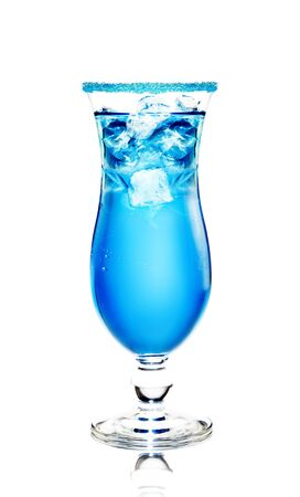 alcoholic cocktail  Blue Lagoon  with ice on a white background  The edge of the glass is decorated with blue sugar