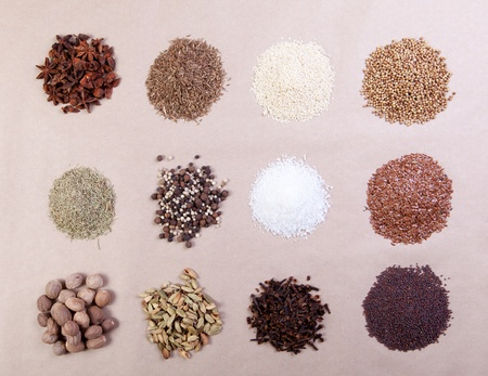 Large spice selection, isolated over paper background photo