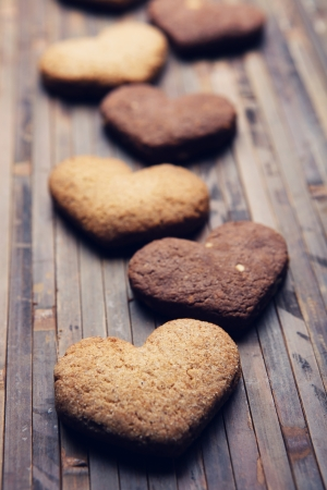 cookies in the shape of heart on a wooden background photo