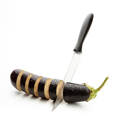 soppy: sharp knife, cut the wet eggplant into pieces on white background