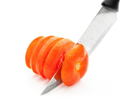 soggy: sharp knife, cut into pieces of wet tomato on a white background