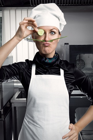 Professional female chef with a mustache and a slice of cucumber in a pince-nez, copies of Salvador Dali