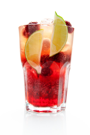 cocktail with fresh raspberries, lime slices and ice on a white background Stock fotó