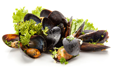 Fresh mussels with herbs and garlic on a white background