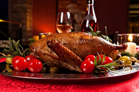 duck: Christmas roast duck served on a festive table