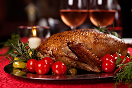 roast turkey: Christmas roast duck served on a festive table