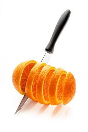 r sliced: sliced orange r sharp knife on a white background