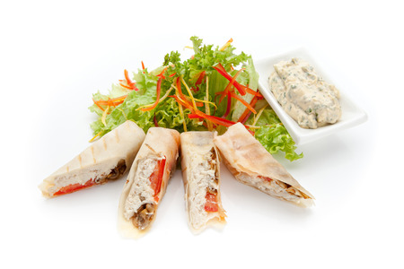 pita stuffed with chicken, mushrooms and tomato, decorated with fresh salad on a white background photo