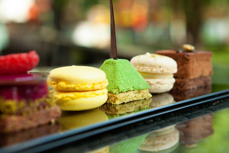 Gorgeous view of different cakes and biscuits, served in outdoors photo