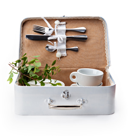 white handmade box for a picnic with tableware on white background