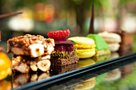 Gorgeous view of different cakes and biscuits, served in outdoors Stock Photo