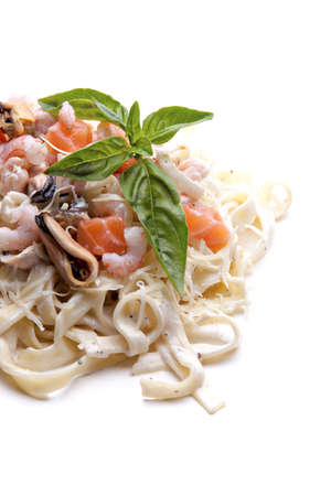 pasta with seafood mussels and shrimp on a white background photo