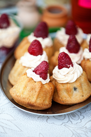 Freshly baked homemade berry muffins with fresh strawberries and cream  photo